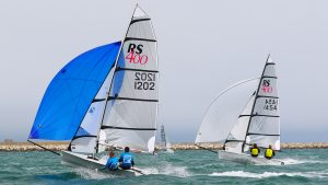 Two RS400 Sailing Dinghy racing downwind with their blue and white asymmetric kites up. Going very fast!