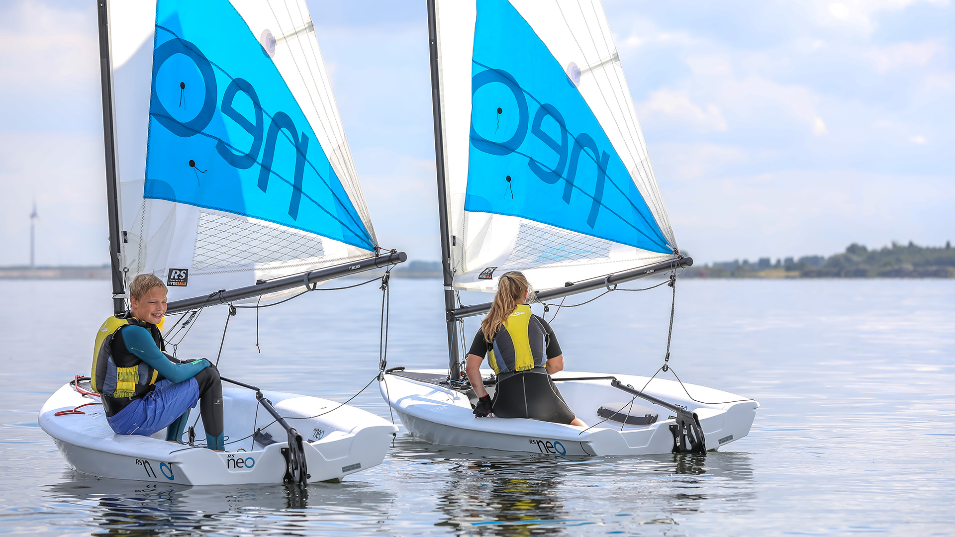 Two RS Neo Sailing boats with children learning to sail.